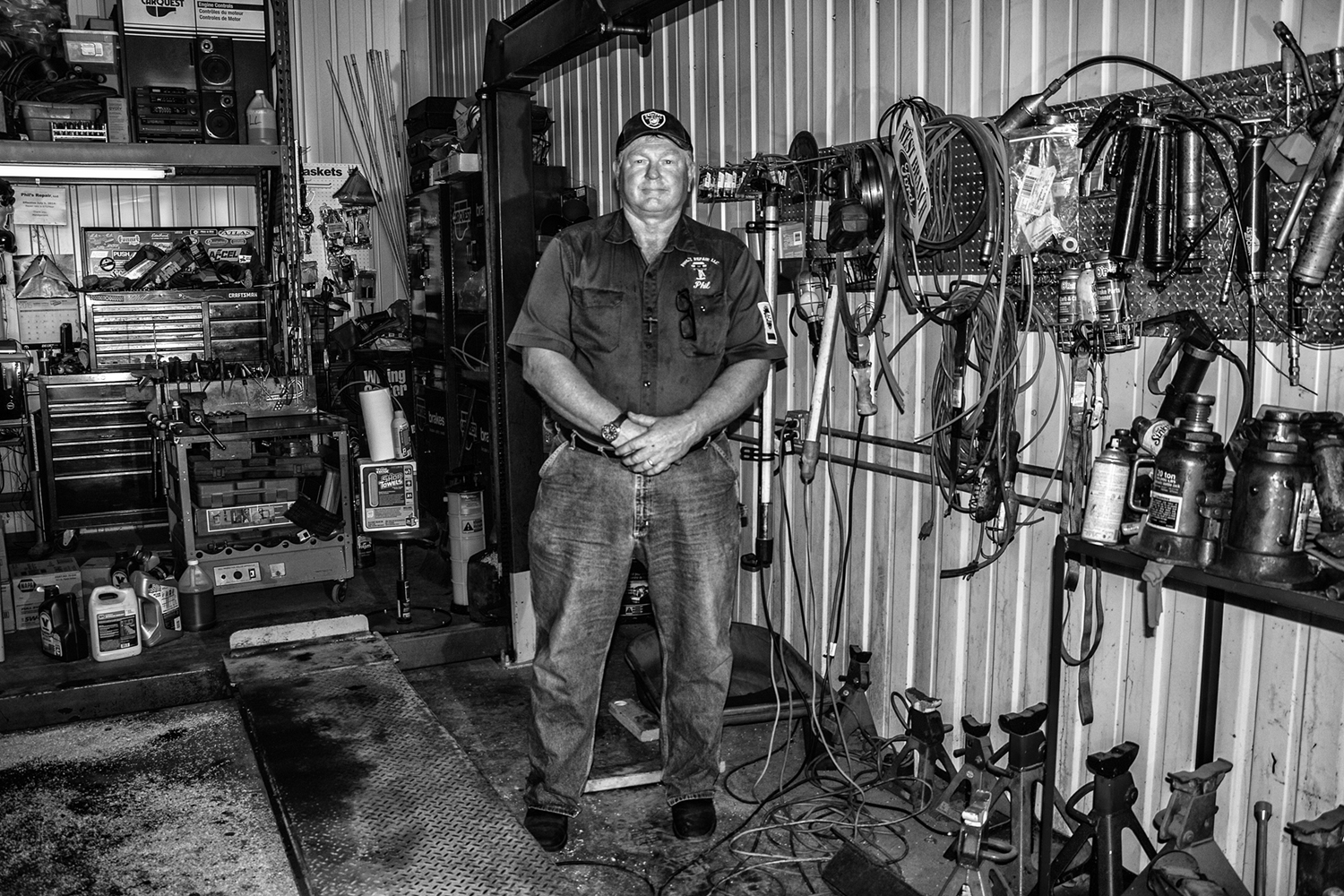 Johnson County supervisor candidate Phil Hemingway stands for a portrait in his mechanic shop on Wednesday. The Johnson County Republican Party has nominated Hemingway to run for county supervisor.
