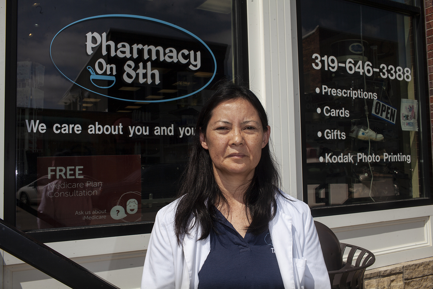 Pharmacist Tess de Jesus-Roetlin poses for a portrait in front of Pharmacy on 8th in Wellman Iowa, which she owns and operates, on Wednesday, Aug. 29, 2018. De Jesus-Roetlin says that the loss of local pharmacies in rural communities can create difficulties for patients in accessing their medication and information about treatment options, especially among elderly patients.