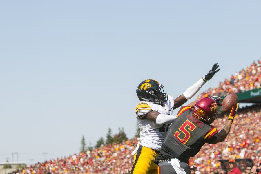 Iowa defensive back Michael Ojemudia breaks up a pass to Allen Lazard in the end zone during the Iowa/Iowa State game for the Cy-Hawk trophy in Jack Trice Stadium on Saturday, Sept. 9, 2017. The Hawkeyes defeated the Cyclones, 44-41, in overtime.