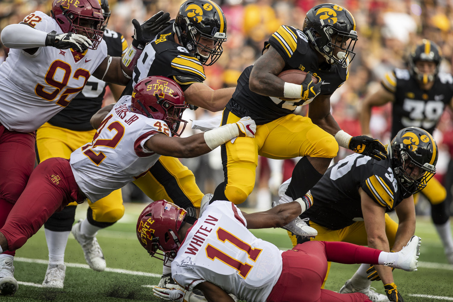 Iowa running back Mekhi Sargent carries the ball during Iowa's game against Iowa State at Kinnick Stadium on Saturday, September 8, 2018.  The score is tied at the half 3-3.