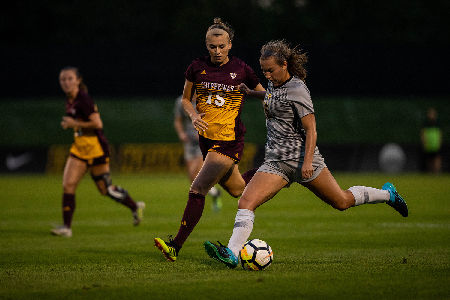 Iowa defender Riley Whitaker crosses the ball during Iowa's game against Central Michigan on Friday, Aug. 31, 2018. The Hawkeyes defeated the Chippewas 3-1.