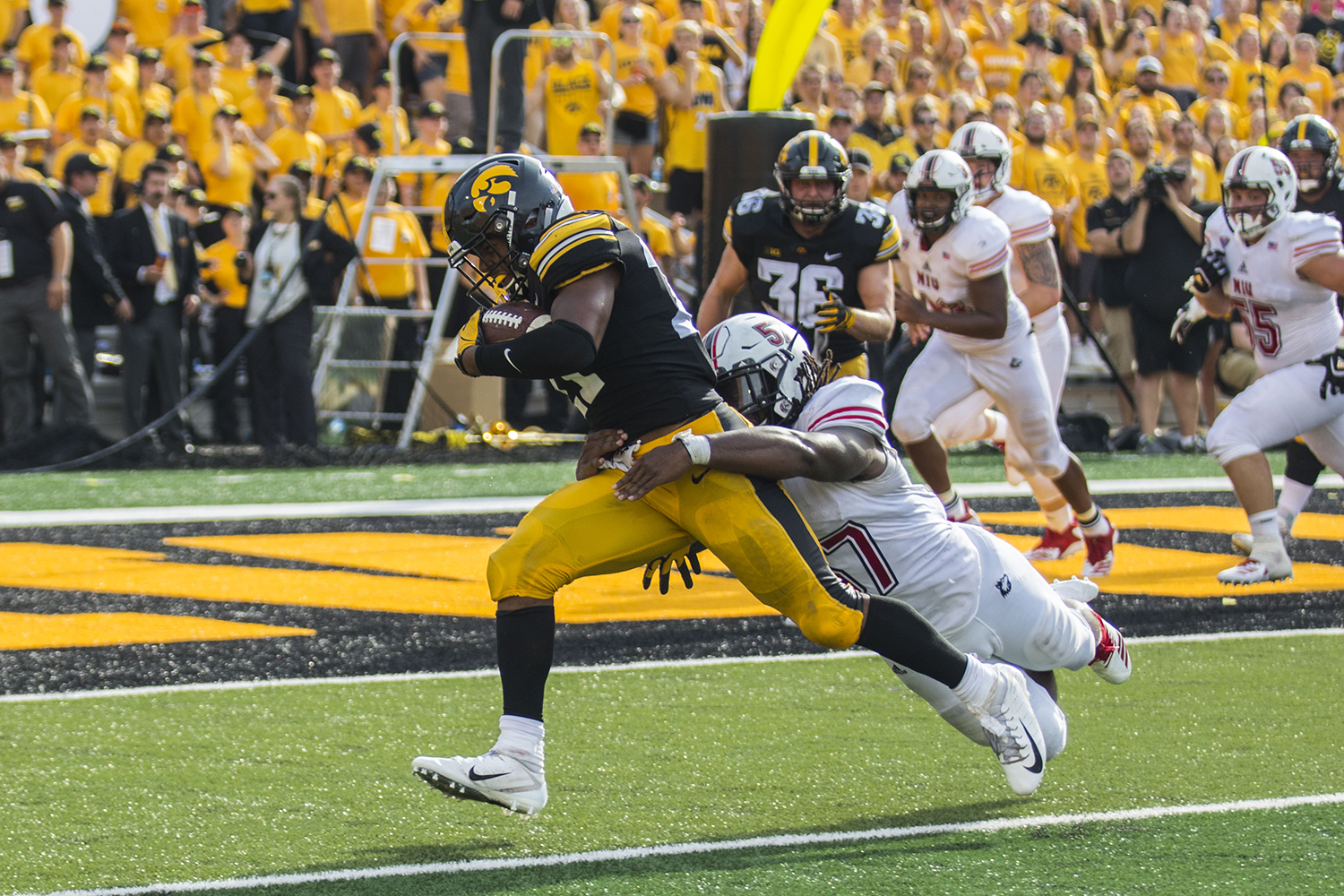 Iowa's Ivory Kelly-Martin sheds a tackle from NIU's Kyle Pugh during the Iowa/NIU football game at Kinnick Stadium on Saturday, Sept. 1, 2018. The Hawkeyes defeated the Huskies, 33-7.