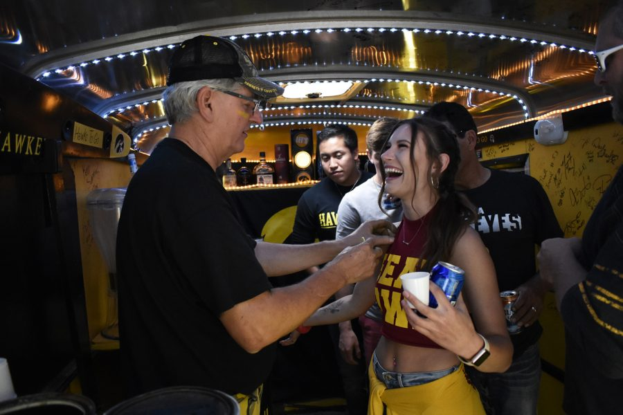 Haley Jennings of Ames, Iowa receives a button for taking her first shot in the Hawks-To-Go taligate trailer on Golfview Ave on Saturday, Sept. 8, 2018. All proceeds donated from trailer participants go directly to the University of Iowa's Children's Hospital. Both Hawkeye and Cyclone fans tailgated throughout Iowa City prior to the annual Iowa vs. Iowa State football game.