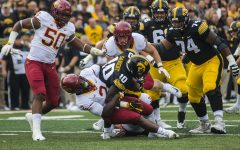 Iowa's Mekhi Sargent gets tackled by Iowa State's Willie Harvey during the Iowa/Iowa State football game at Kinnick Stadium on Saturday, Sept. 8, 2018. The Hawkeyes defeated the Cyclones, 13-3.