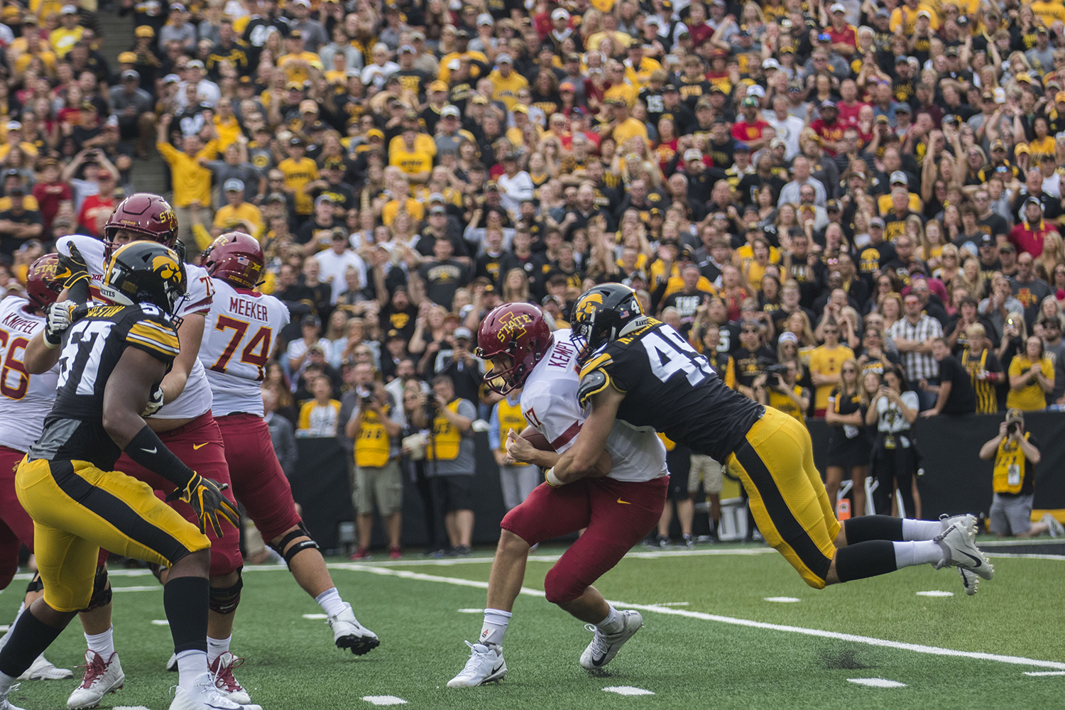 Iowa State quarterback Kyle Kempt gets sacked by Iowa linebacker Nick Niemann during the Iowa/Iowa State football game at Kinnick Stadium on Saturday, September 8, 2018. The Hawkeyes defeated the Cyclones, 13-3.