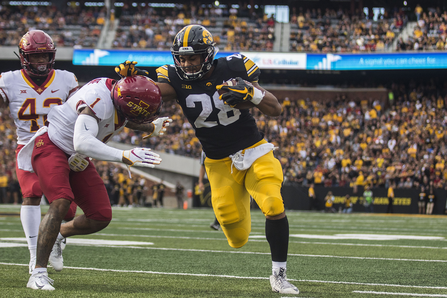 Iowa's Toren Young attempts to stop Iowa State's D'Andre Payne's tackle during the Iowa/Iowa State football game at Kinnick Stadium on Saturday, September 8, 2018. The Hawkeyes defeated the Cyclones, 13-3.
