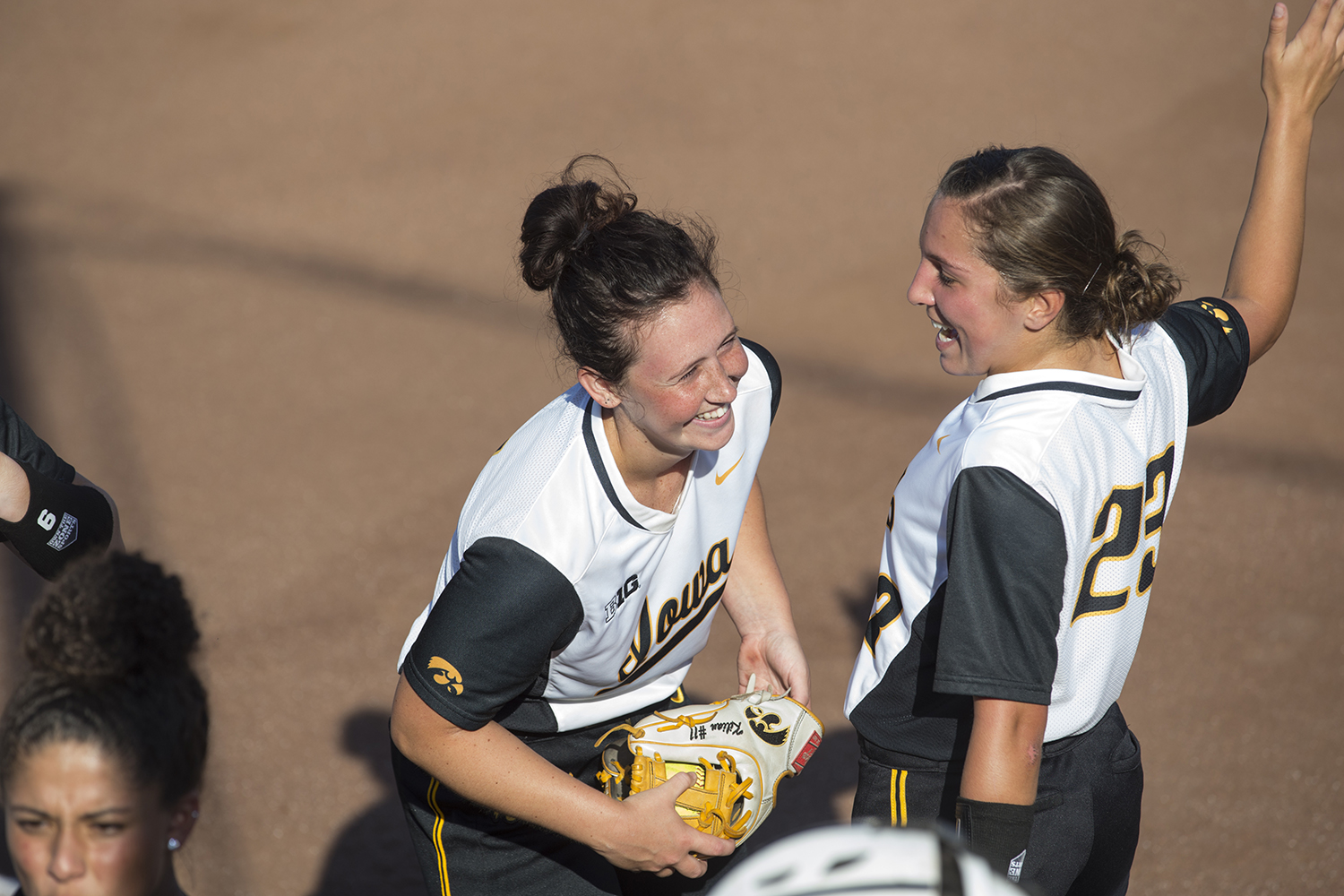 Senior Mallory Kilian and junior Alex Rath joke around during the Iowa v Kirkwood softball game at the Pearl Softball Complex in Coralville on Sept. 14, 2018. The Hawkeyes defeated the Kirkwood Eagles 10-6.