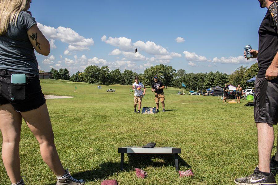 (From left) Danielle Williams, Ted Tecklenburg, Colton Steele, and Shane Gamerdinger compete in a game of bags while tailgating prior to the football match between Northern Iowa and Iowa on Saturday, September 15, 2018.