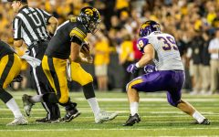 Iowa Hawkeyes quarterback Nate Stanley (4) squares up for contact during a game against Northern Iowa at Kinnick Stadium on Saturday, Sept. 15, 2018. The Hawkeyes defeated the Panthers 38–14.
