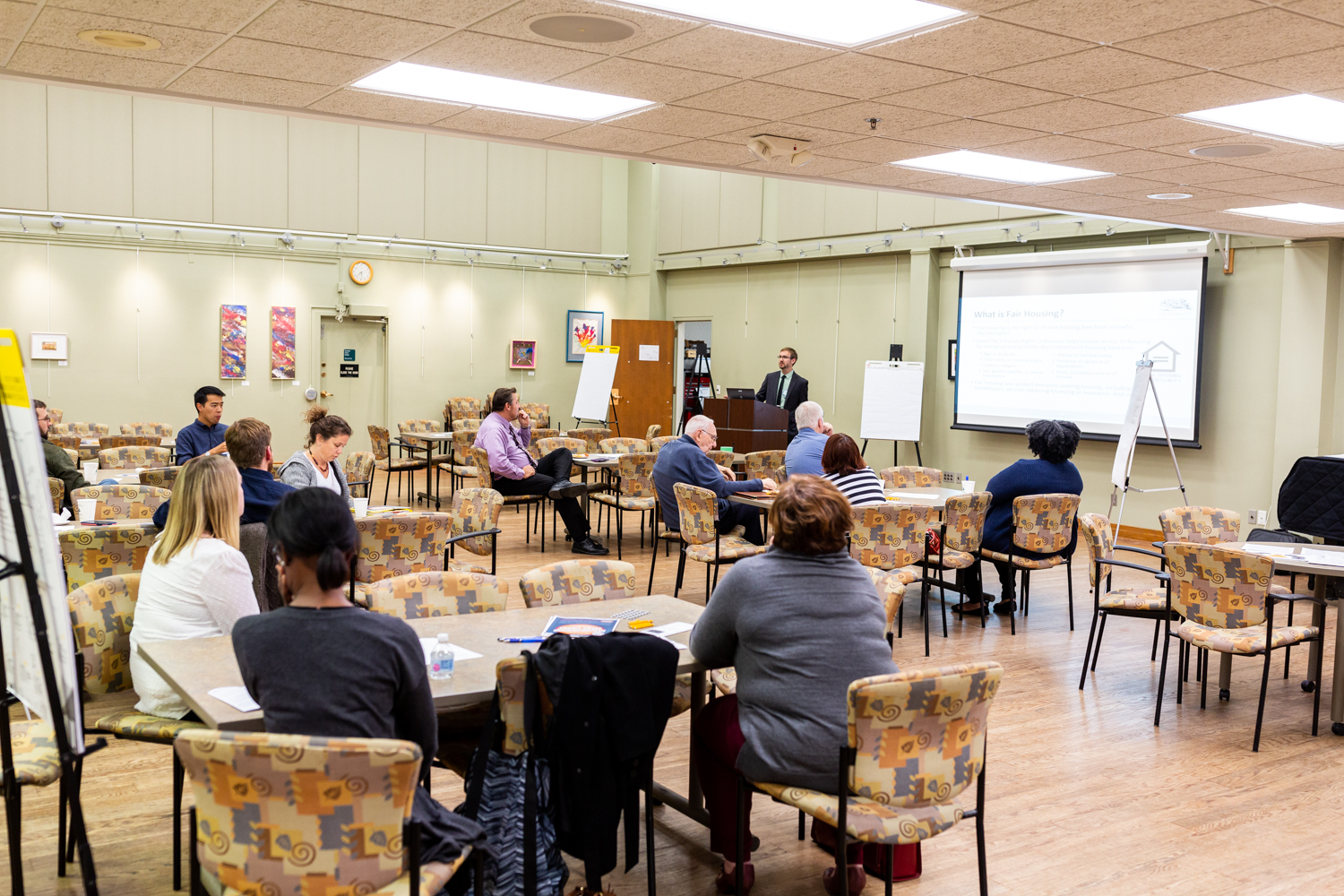 Participants in a meeting about issues regarding fair housing in Iowa City listen to Kirk Lehman present on the issue at the Iowa City Senior Center on Thursday, Sept. 27, 2018.