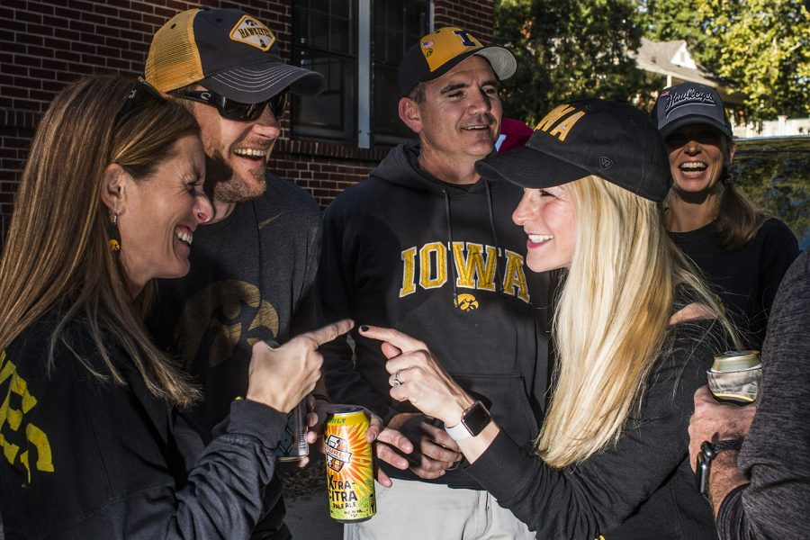 Iowa+alumni+laugh+outside+of+Kinnick+Stadium+on+Saturday%2C+September+22%2C+2018.+Both+Hawkeye+and+Badger+fans+tailgated+throughout+Iowa+City+prior+to+the+Iowa+vs.+Wisconsin++football+game.+