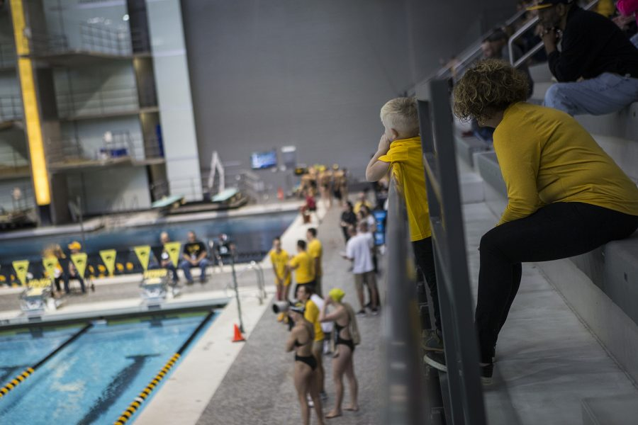 A+young+fan+watches+during+the+Iowa+Swimming+and+Diving+Intrasquad+Meet+at+the+Campus+Recreation+and+Wellness+Center+on+Saturday%2C+September+29%2C+2018.+
