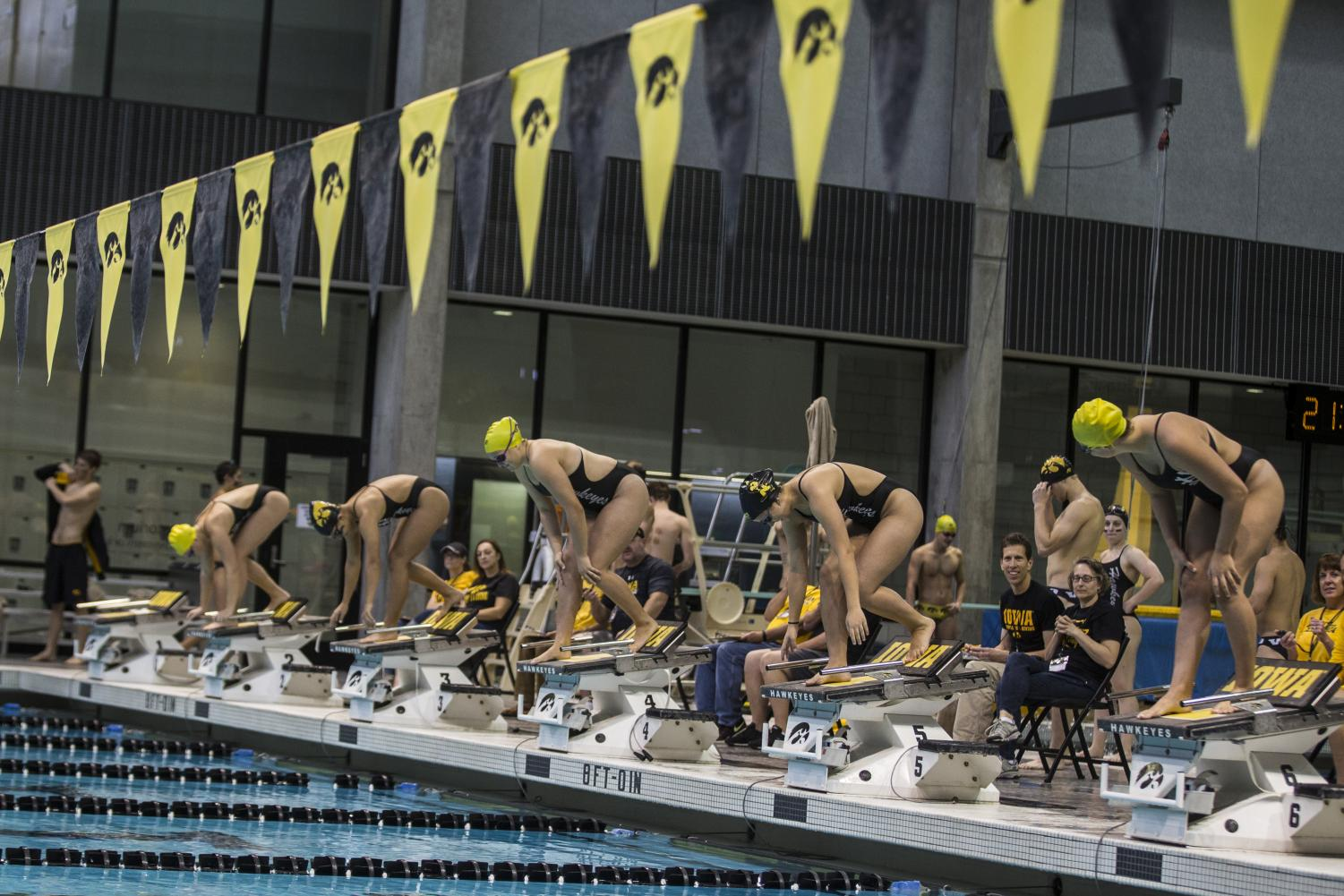 Swimmers line up on the blocks during the Iowa Swimming and Diving Intrasquad Meet at the Campus Recreation and Wellness Center on Saturday, Sept. 29, 2018.