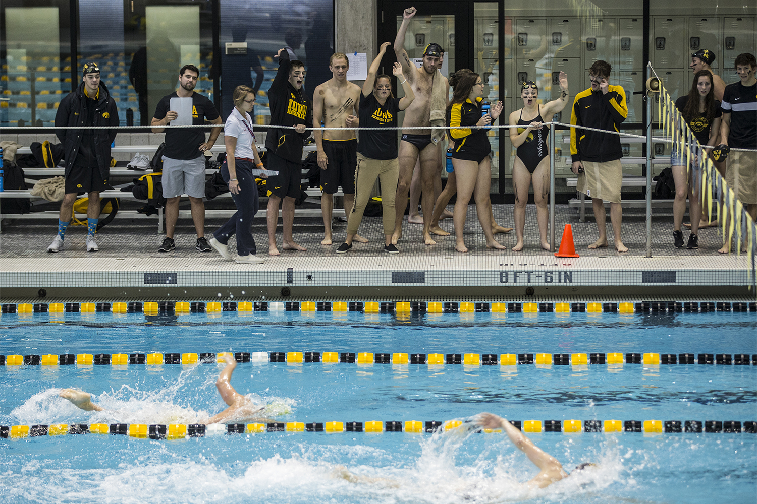 The+Iowa+swim+team+cheers+on+competitors+during+the+Iowa+Swimming+and+Diving+Intrasquad+Meet+at+the+Campus+Recreation+and+Wellness+Center+on+Saturday%2C+September+29%2C+2018.+