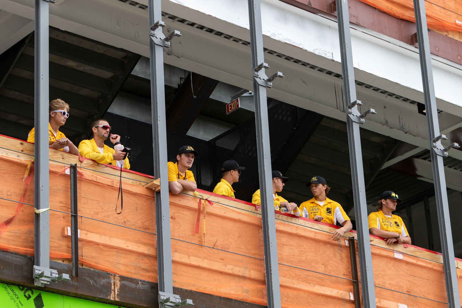 Stadium staff watches the growing crowd from a construction area in the north end zone of Kinnick Stadium before a football game against Iowa State University on Saturday, Sep. 8, 2018.