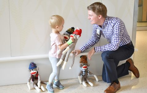 UIHC pediatric patients who have lost an eye receive winking sock monkeys