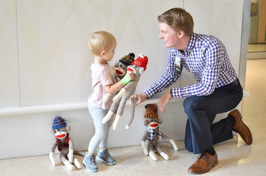 UIHC pediatric patients who have lost an eye receive winking sock monkeys