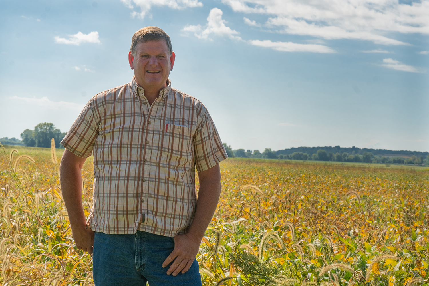 Kevin Kinney stands in a field on Sept. 14, 2018 in Iowa City outside of Midtown Family Restaurant.