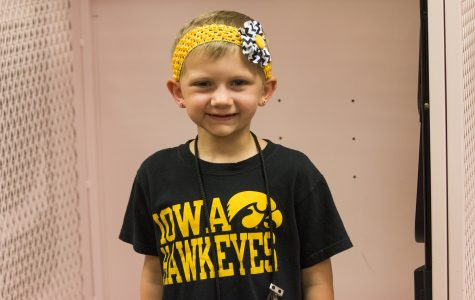 6-year-old celebrates completing cancer treatment at Cy-Hawk game