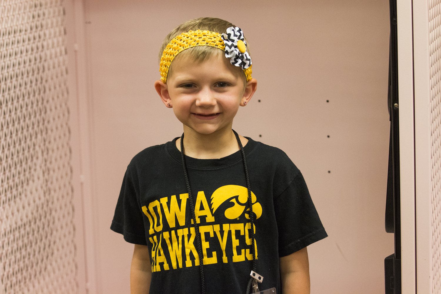 Kid Captain Harper Stribe smiles for a portrait during Iowa football Kid's Day at Kinnick Stadium on Saturday, Aug. 11, 2018. The 2018 Kid Captains met the Iowa football team and participated in a behind-the-scenes tour of Kinnick Stadium.
