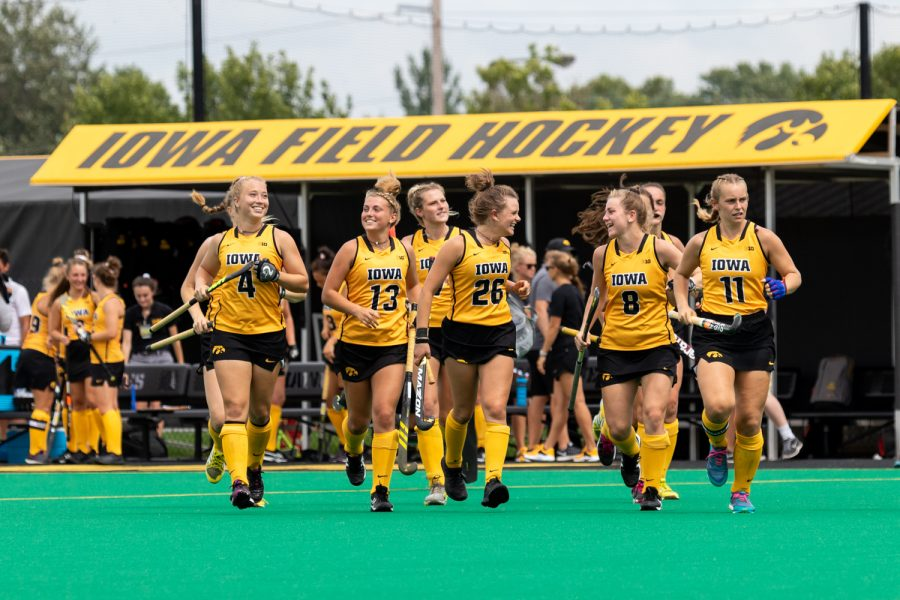 Iowa+field+hockey+players+run+onto+the+field+before+a+game+against+Ball+State+on+Sunday%2C+Sept.+2%2C+2018.+The+Hawkeyes+defeated+the+Cardinals+7%E2%80%931.