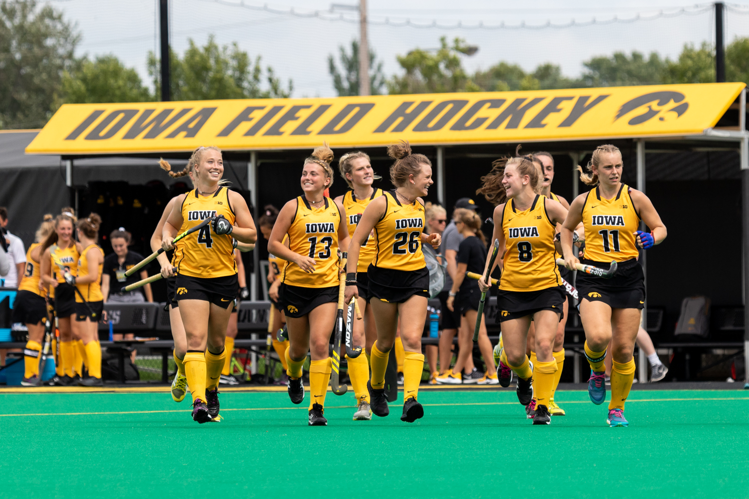 Iowa field hockey players run onto the field before a game against Ball State on Sunday, Sept. 2, 2018. The Hawkeyes defeated the Cardinals 7–1.