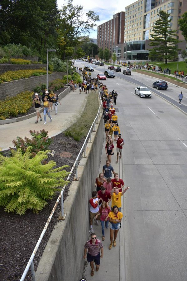 Crowds of Hawkeye and Cyclone fans are seen walking together down Burlington Street on Saturday, September 8, 2018. Both Hawkeye and Cyclone fans tailgated throughout Iowa City prior to the annual Iowa vs. Iowa State football game.