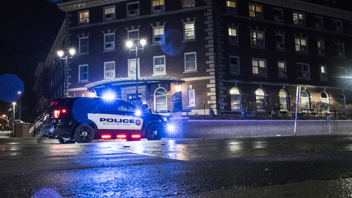 Iowa City and University of Iowa police respond to loud bangs at Currier Residence Hall on Wednesday, Feb. 28, 2018.