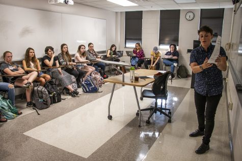 Students listen to instructor Sara McGuirk in the