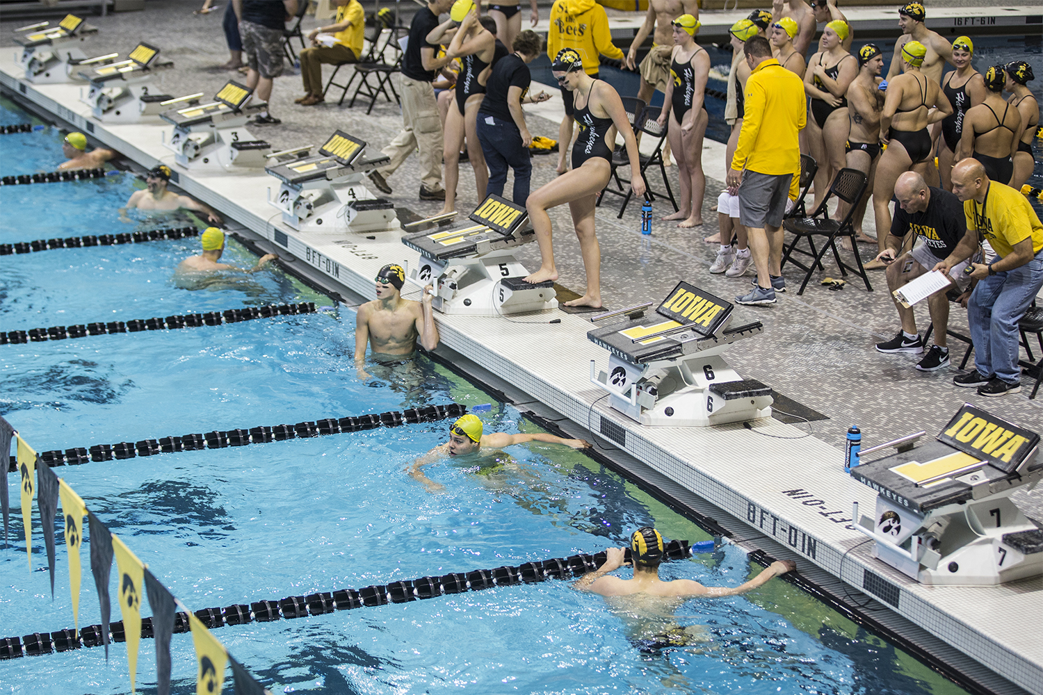 Swimmers+look+to+the+board+to+see+their+times+during+the+Iowa+Swimming+and+Diving+Intrasquad+Meet+at+the+Campus+Recreation+and+Wellness+Center+on+Saturday%2C+Sept.+29%2C+2018.+