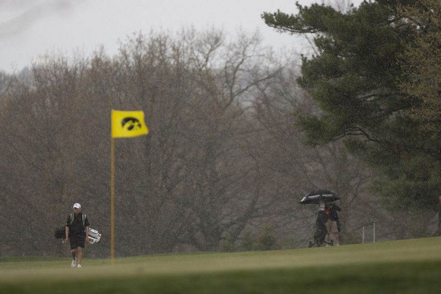 Iowa%27s+Matthew+Walker+walks+on+the+green+in+a+downpour+during+the+Hawkeye+Invitational+at+Finkbine+Golf+Course+on+Saturday%2C+April+15%2C+2017.+