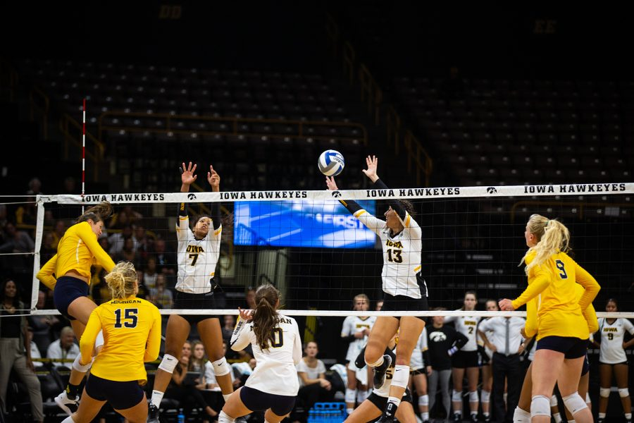 Sarah+Wing+and+Brie+Orr+jump+to+block+the+ball+during+Iowa%27s+match+against+Michigan+at+Carver-Hawkeye+Arena+on+Sept.+23%2C+2018.+The+Hawkeyes+were+defeated+3-1.+