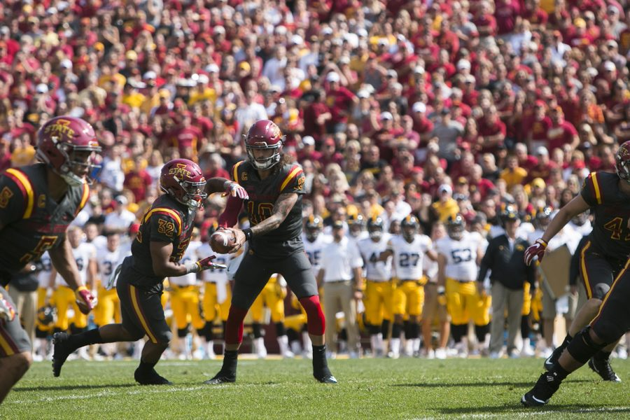 Iowa State quarterback Jacob Park hands off a ball to running back David Montgomery during the Iowa/Iowa State game for the Cy-Hawk trophy in Jack Trice Stadium on Saturday, Sept. 9, 2017.