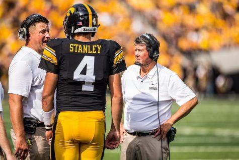 Iowa quarterback Nate Stanley talks with offensive coordinator Brian Ferentz during Iowa