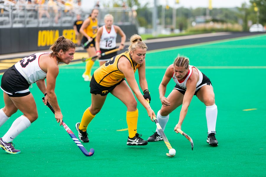 Iowa%27s+Leah+Zellner+fights+for+control+of+the+ball+during+a+field+hockey+match+against+Ball+State+on+Sunday%2C+Sept.+2%2C+2018.+The+Hawkeyes+defeated+the+Cardinals+7%E2%80%931.+