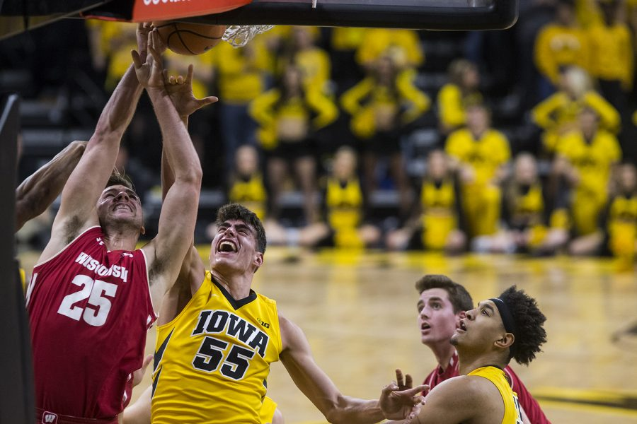 Iowa%27s+Luka+Garza+%2855%29+and+Wisconsin%27s+Alex+Illikainen+%2825%29+jump+for+the+rebound+during+the+NCAA+men%27s+basketball+game+between+Iowa+and+Wisconsin+at+Carver-Hawkeye+Arena+on+Tuesday%2C+Jan.+23%2C+2018.+