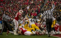 Referees attempt to spot the football during Iowa's game against Wisconsin at Camp Randall Stadium on Saturday, Nov. 11, 2017. The badgers defeated the Hawkeyes 38-14.