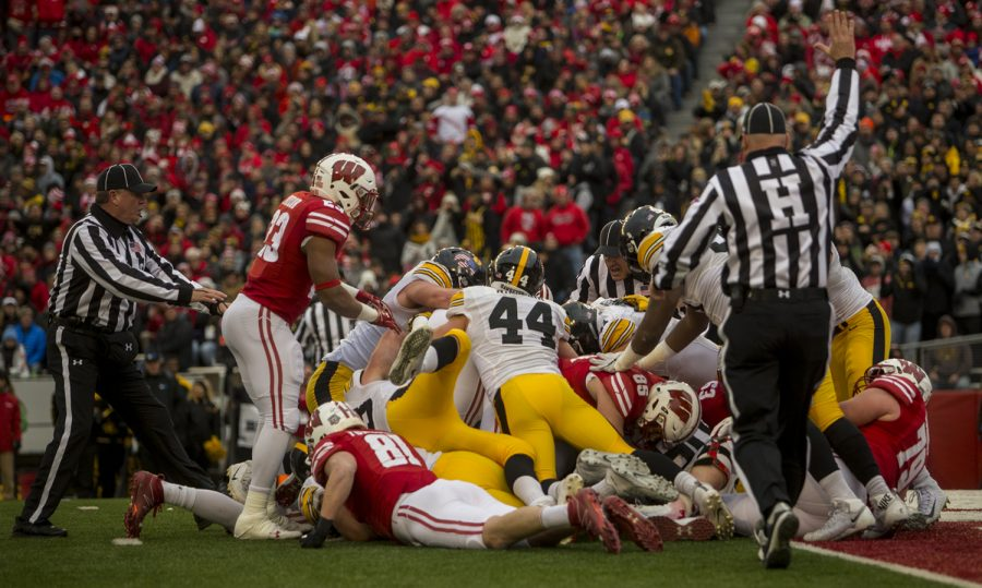 Referees+attempt+to+spot+the+football+during+Iowa%27s+game+against+Wisconsin+at+Camp+Randall+Stadium+on+Saturday%2C+Nov.+11%2C+2017.+The+badgers+defeated+the+Hawkeyes+38-14.+