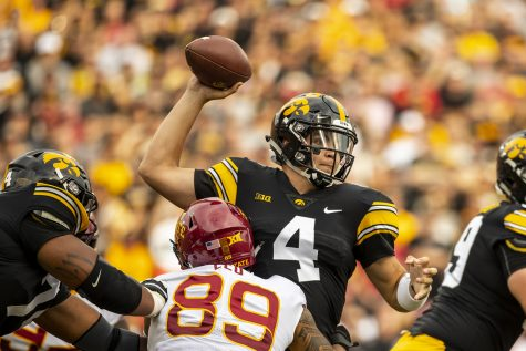 Iowa quarterback Nate Stanley throws under pressure during Iowa's game against Iowa State at Kinnick Stadium on Saturday, Sept. 8, 2018. The Hawkeyes defeated the Cyclones 13-3.