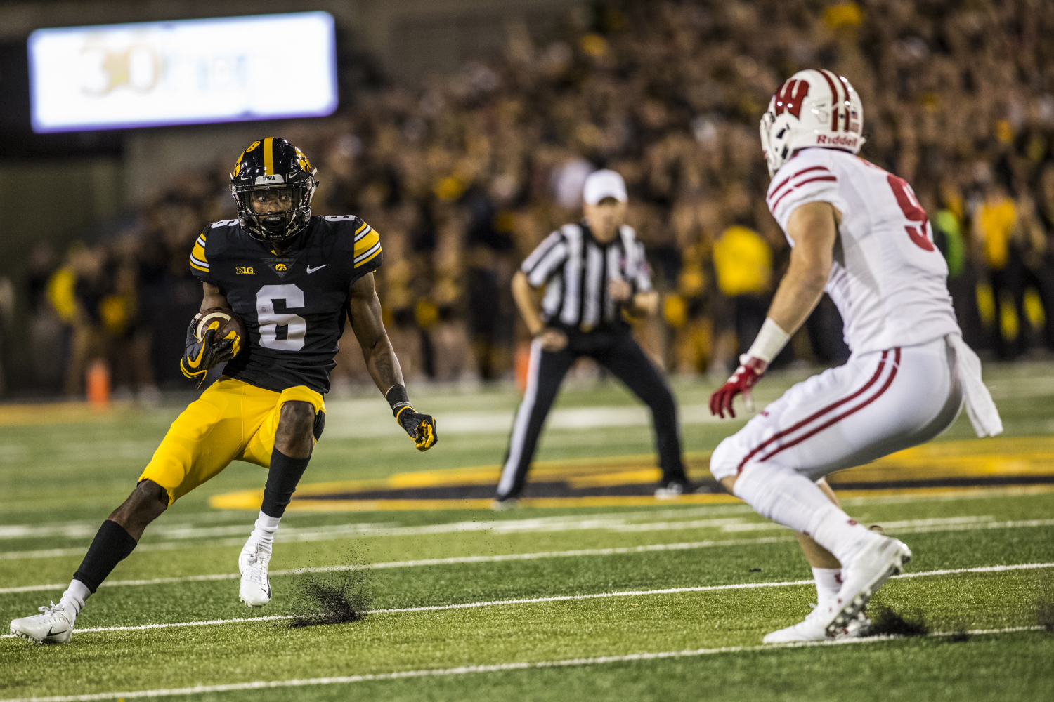 Iowa wide receiver Ihmir Smith-Marsette makes a cut during Iowa's game against Wisconsin at Kinnick Stadium on Saturday, Sept. 22, 2018. The Badgers defeated the Hawkeyes 28-17.