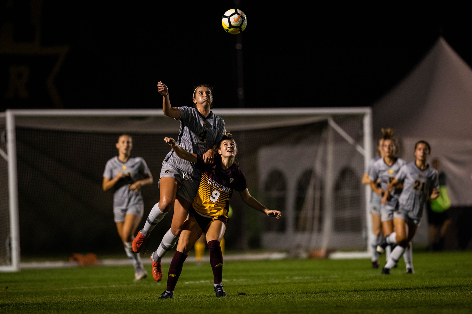 Iowa forward Kaleigh Haus wins a header during Iowa's game against Central Michigan on Friday, Aug. 31, 2018. The Hawkeyes defeated the Chippewas 3-1.