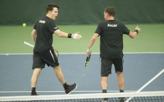 Iowa's Kareem Allaf and Jonas Larsen celebrate during a tennis match between Iowa and Western Michigan in Iowa City on Friday, Jan. 19, 2018. The Hawkeyes earned the doubles point but lost the match overall, 5-2.