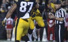 Iowa's Noah Fant and TJ Hockenson celebrate a touchdown during a football game between Iowa and Wisconsin on Saturday, Sept. 22, 2018. The Badgers defeated the Hawkeyes, 28-17.