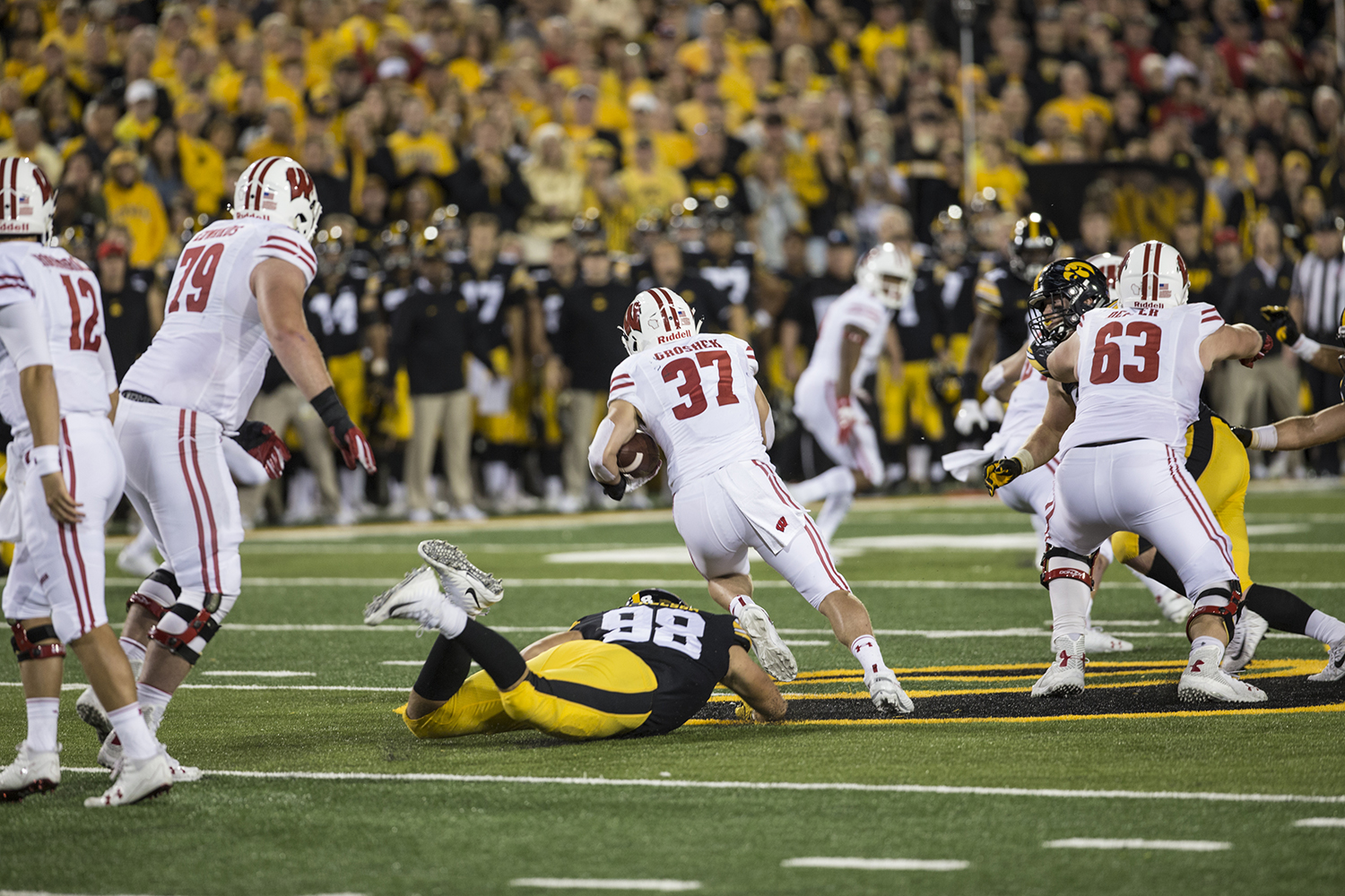 Wisconsin's Garrett Groshek avoids a tackle during a football game between Iowa and Wisconsin on Saturday, Sept. 22, 2018. The Badgers defeated the Hawkeyes, 28-17.