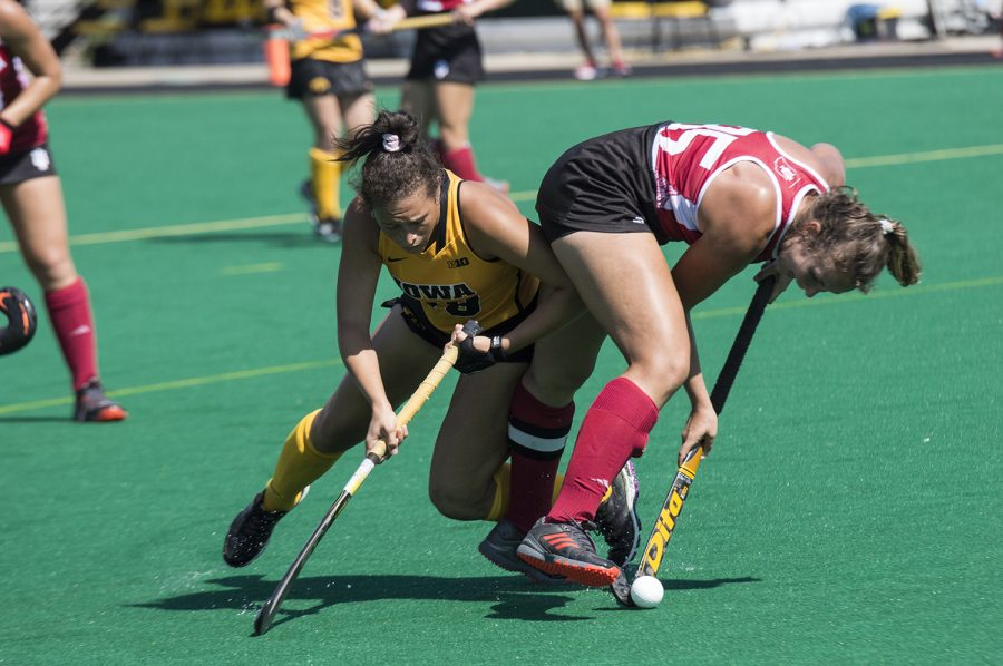 Iowa's Mya Christopher fights for the ball during the Indiana field hockey game on Sunday, Sept. 16 2018. The Hawkeyes defeated the Hoosiers (3-0), and have now won six consecutive games.