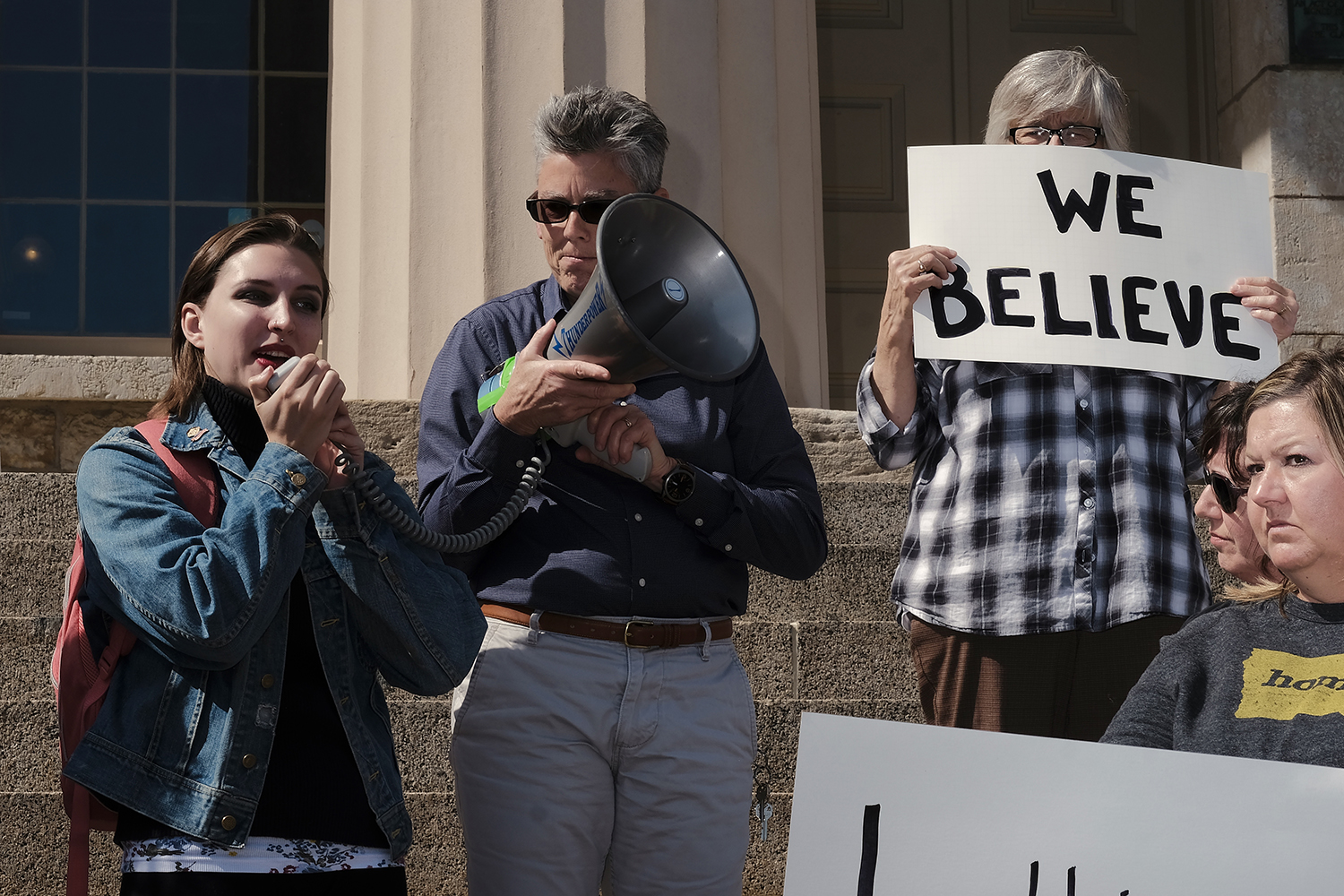 Community members gather on the steps of the Old Capitol in Iowa City on Thursday, Sept. 27, 2018 to protest the nomination of Judge Brett Kavanaugh to the Supreme Court. Protesters spoke in support of victims of sexual violence and shared personal stories about coming forward as victims of sexual violence.