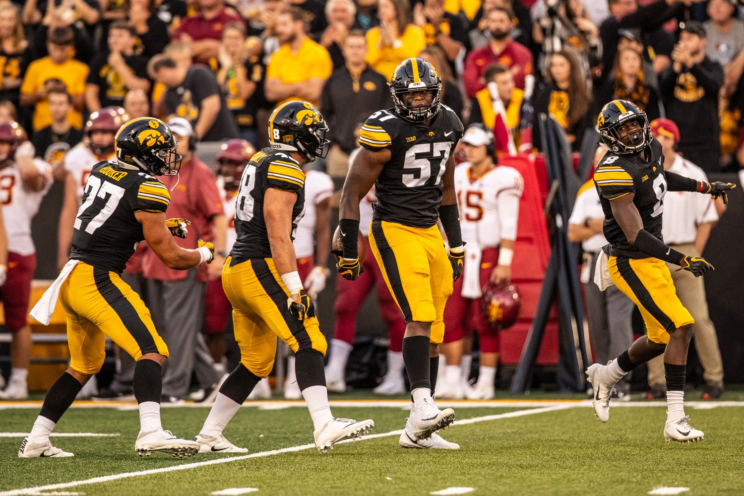 Iowa defensive players celebrate a stop during Iowa's game against Iowa State at Kinnick Stadium on Saturday, September 8, 2018. The Hawkeyes defeated the Cyclones 13-3.