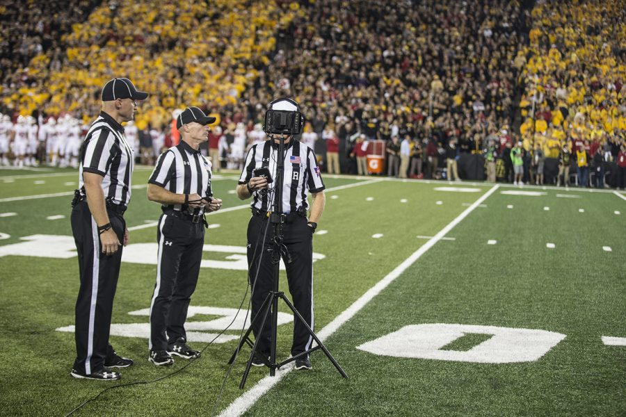 Referees+perform+a+video+review+after+Iowa+punt+returner+Kyle+Groenwing+fumbled+during+a+return+during+a+football+game+between+Iowa+and+Wisconsin+on+Saturday%2C+September+22%2C+2018.+The+Badgers+defeated+the+Hawkeyes%2C+28-17.