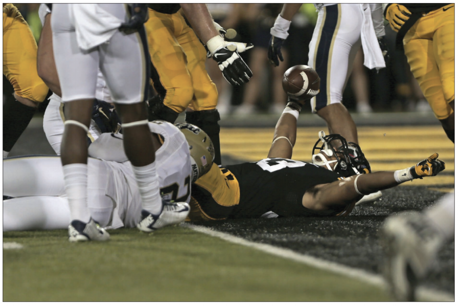 Hawkeye running back Jordan Canzeri (33) scores a touchdown against Pittsburgh on Sept. 19, 2015.