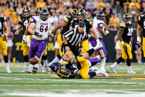 Iowa Hawkeyes wide receiver Nick Easley (84) is taken to the turf as the ball bounces away during a game against Northern Iowa at Kinnick Stadium on Saturday, Sept. 15, 2018. The Hawkeyes defeated the Panthers 38–14.